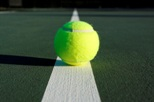 Tennis Ball Centered on the Court